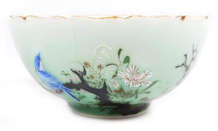 A Chinese bowl, the celadon glazed semi-translucent body having an oriental blue bird and flower