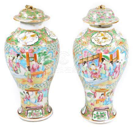A pair of 19thC Chinese baluster vases and covers, decorated in famille vert Cantonese enamels