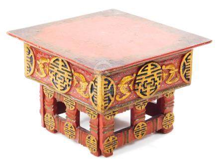A 19thC red lacquer box, with an articulated mesh work style wooden top, set with oriental