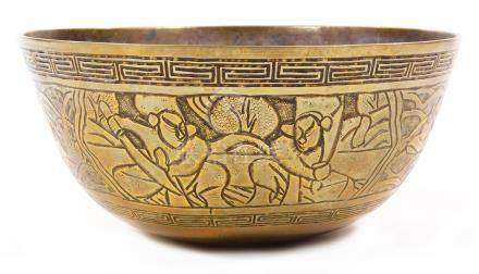 A Chinese polished bronze bowl, of circular outline raised with a double Greek key style banding and