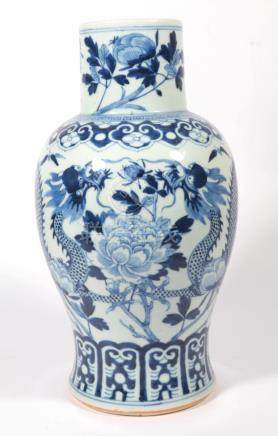 A Chinese blue and white baluster porcelain vase, decorated with a trailing dragon amongst flowering