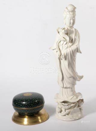 A Chinese Blanc de Chine model of Guanyin; and a Cloisonne enamel box and cover (2)