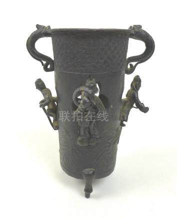 A Chinese bronze brush pot, with figures in relief against pierced clouds,