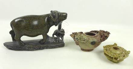A group of three Chinese soapstone carvings, 20th century, one modelled as a buffalo with young,