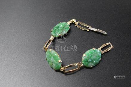 14 k gold and jadeite bracelet.