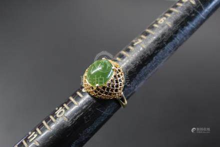 14K gold and jade ring.