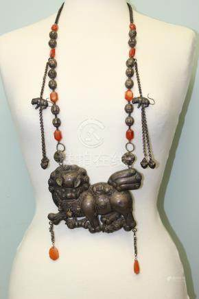 A very rare Chinese silver necklace with large silver foo dog pendant.
