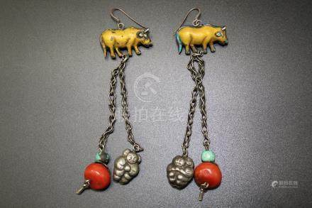 A pair of Chinese silver and red coral earrings.