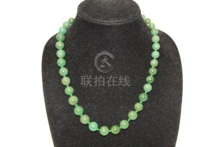 Chinese spinach jade bead necklace.