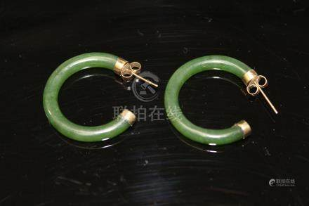 Pair of Chinese spinach jade and 14 K earrings.