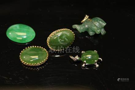 A group of Chinese jade jewelry.