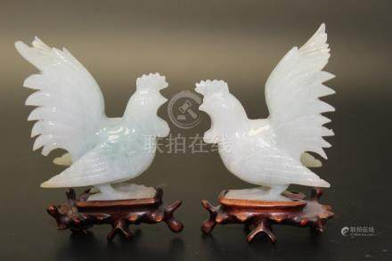 A pair of Chinese carved jadeite roosters.