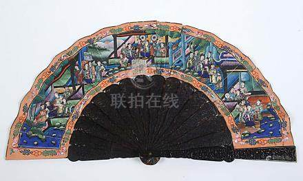 A CHINESE FAN The guards carved with figures & buildings, pierced and carved sticks, painted paper