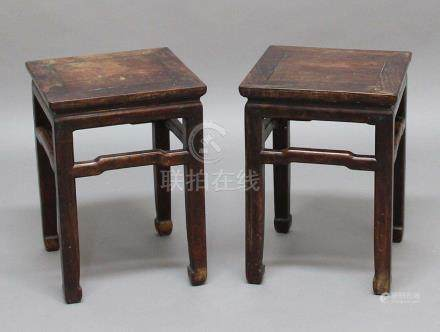 PAIR OF CHINESE HARDWOOD STANDS, late 18th century, the square top above shaped stretchers on square