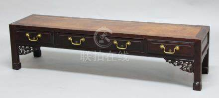 CHINESE HARDWOOD LOW TABLE, the rectangular top above four drawers, floral carved brackets and