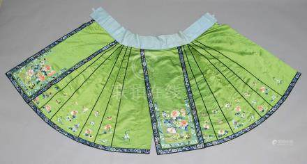 CHINESE SILK AND EMBROIDERED SKIRT, late 19th or early 20th century, the apple green ground worked