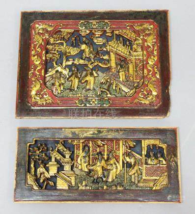 TWO CHINESE CARVED, GILT AND LACQUERED PANELS, 19th century, each carved with figures, trees and a
