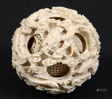 CHINESE CANTON IVORY PUZZLE BALL, 19th century, with 14 concentric balls, the outer ball carved with