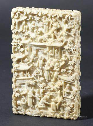 CHINESE CANTON IVORY CARD CASE, carved with figures amongst trees and pavilions, height 10.5cm,