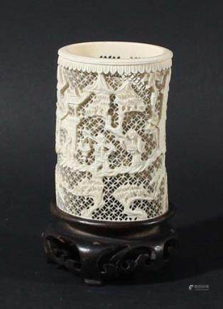 CHINESE IVORY RETICULATED TUSK VASE, later 19th century, carved with figures walking between pine