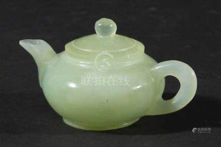 CHINESE CELADON JADE MINIATURE TEAPOT AND COVER, of squat ovoid form, length 9cm (2)