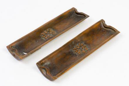 A PAIR OF ARM RESTS WITH FIGURE PATTERN