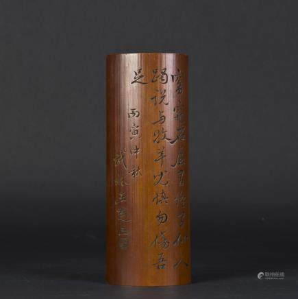 A BAMBOO-CARVED ARM REST WITH CALLIGRAPHY CARVING
