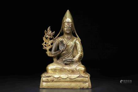 A GILT-BRONZE FIGURE OF TSONG KHAPA