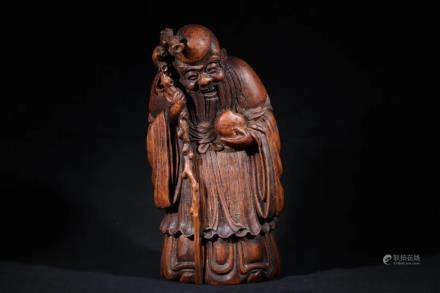 A BAMBOO CARVED FIGURE OF LIFE GOD