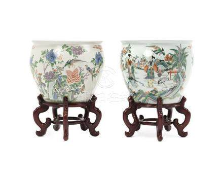 A near pair of Chinese fish bowls on stands