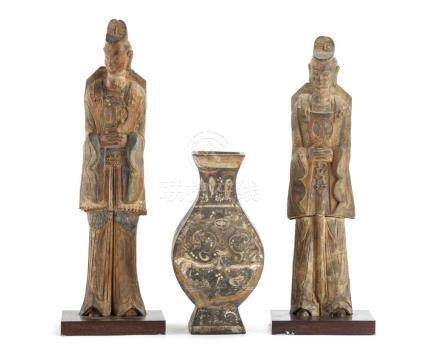 A Chinese vase and two standing court figures