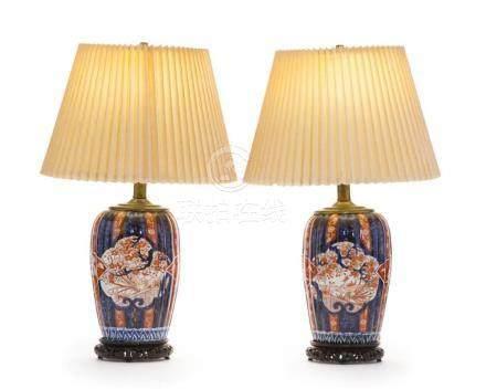 A pair of polychrome Imari lamps