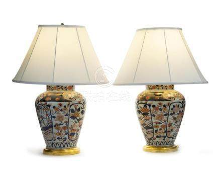 A pair of Imari porcelain lamps white linen shades
