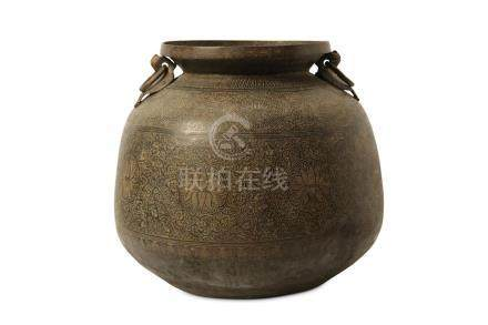A MONUMENTAL INCISED COPPER JAR.