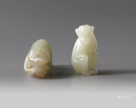 Two Chinese celadon and pale celadon jade monkeys