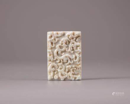 A Chinese white and grey jade plaque