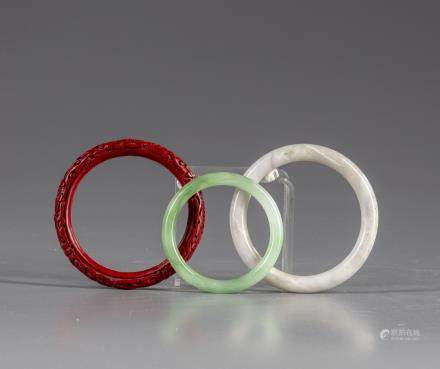 A cinnabar lacquer and two jade bangles