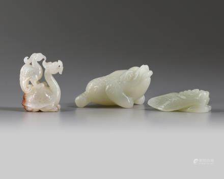 A group of Chinese white and pale celadon jade mythical beast carvings
