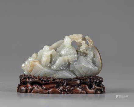 A celadon jade carving of a lady  and a boy