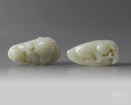 Two large Chinese pale celadon jade 'boys' carvings