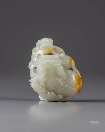 A Chinese white jade 'Buddhist lion and cubs' carving