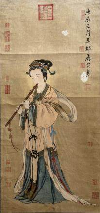 A hand scroll depicting a lady playing the flute