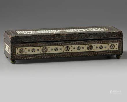 A silver and ivory inlaid wooden box