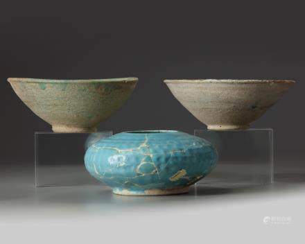 Two Islamic turquoise glazed bowls and a jar