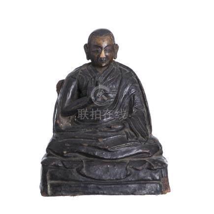 Tibetan wood sculpture of a Lama