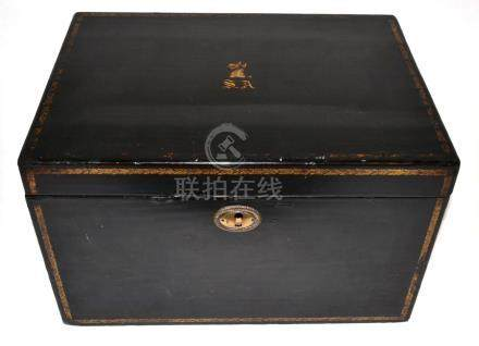 A Chinese Export Lacquer Tea Chest, circa 1815, gilt with a dragon's crest over initials SA,