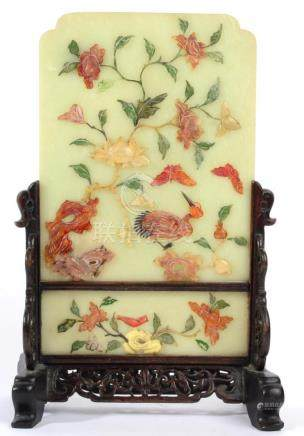 A Chinese Jade Table Screen, of arched rectangular form, inlaid in coloured hardstones with a