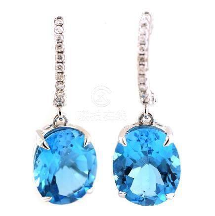 Pair of Blue Topaz, Diamond, 14k White Gold Earrings.