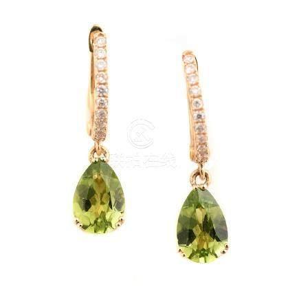 Pair of Peridot, Diamond, 14k Yellow Gold Earrings.