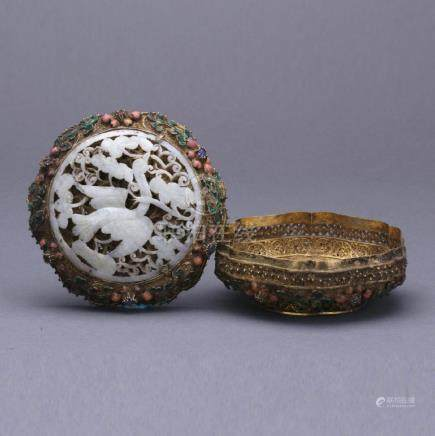 A gilt silver box with white jade, gems decoration